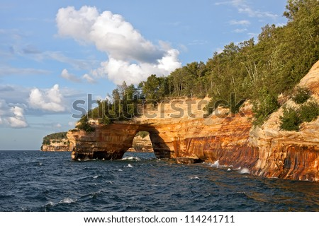 Pictured Rocks National Lakeshore in evening sunlight.These colorful formations are on the Lake Superior shoreline on Michigan's Upper Peninsula. - stock photo