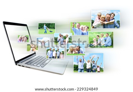 Pictures flying out of the laptop screen - stock photo