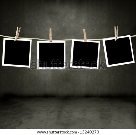 Pictures hanging in a darkroom - stock photo