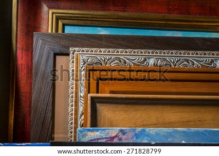 pictures in frames in the workshop - stock photo