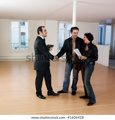pictures inside an empty loft apartment of a couple visiting apartment - stock photo