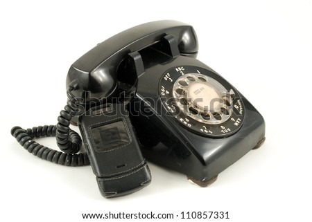Pictures of an older, analog type telephone - stock photo