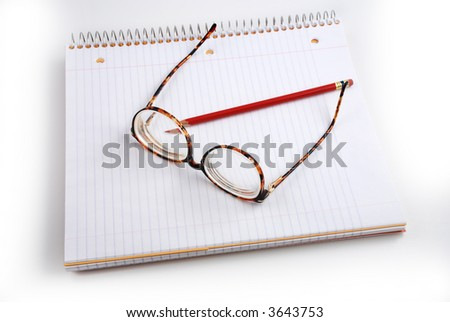 Pictures of glasses resting on a notepad, indicating the writer is taking a break from thinking