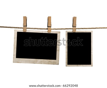 pictures on a rope with clothespins, with clipping path for images - stock photo