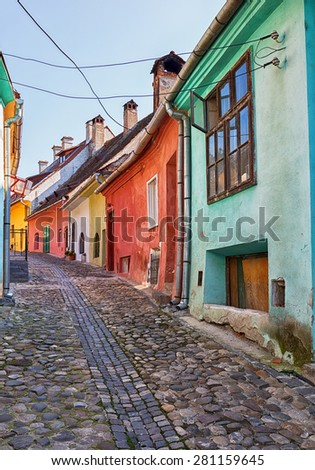 Picturesque alley with colourful houses in Sighisoara, Romania. - stock photo