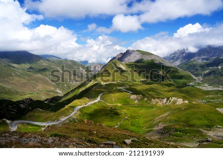 Picturesque Alps landscape with mountain road - stock photo