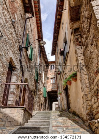 picturesque antique narrow alley with staircase in Todi, Umbria, Italy - stock photo