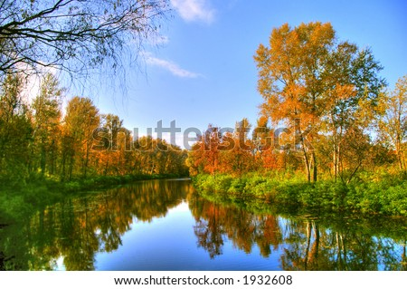Picturesque autumn landscape of river and bright trees and bushes - BEST FOR WEB USE - stock photo