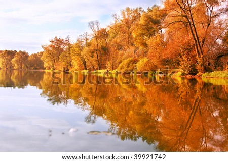 Picturesque autumn landscape on the river - stock photo