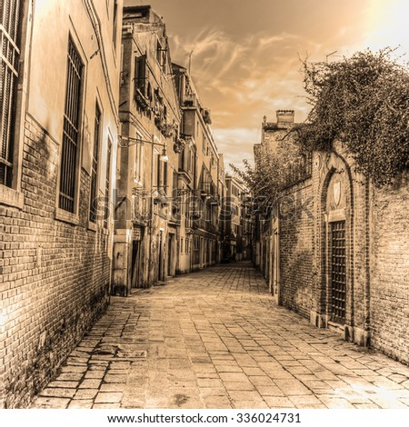 picturesque backstreet in Venice in sepia tone, Italy - stock photo