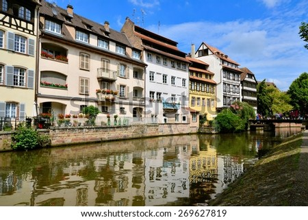 Picturesque canal houses with reflection in the Petite France neighborhood of Strasbourg - stock photo