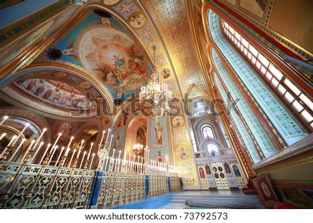 Picturesque ceiling, the view from the balcony adorned by candles inside Cathedral of Christ the Saviour in Moscow, Russia - stock photo
