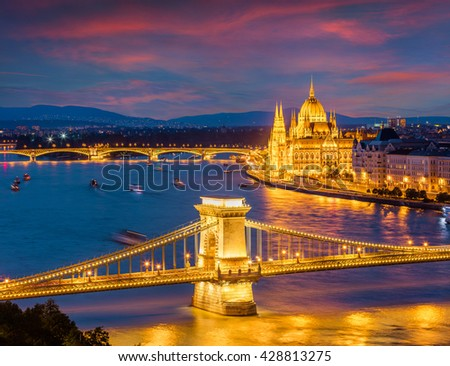 Picturesque cityscape of Hungarian parliament building with famous Chain Bridge on the Danube river. Dramatic spring  sunset in Budapest, Hungary, Europe. Artistic style post processed photo. - stock photo
