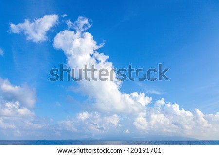Picturesque clouds over the sea. - stock photo
