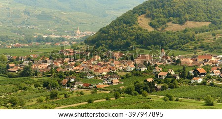 picturesque European town far away. Scenic mountain landscape with small old beautiful village. Danube Valley of the Wachau, Austria - stock photo