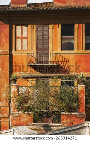 Picturesque facade of a residential home in Rome, Italy - stock photo