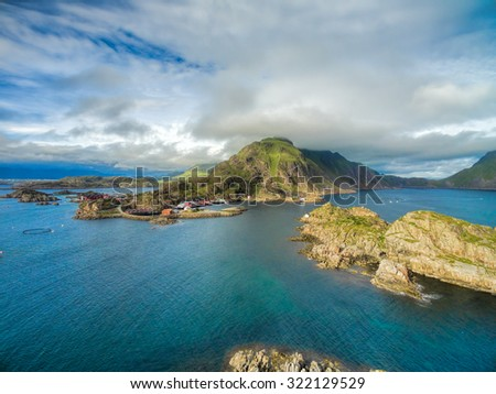 Picturesque fishing village on the coast of Lofoten islands in Norway - stock photo