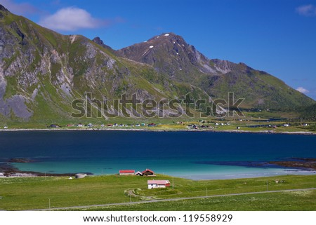 Picturesque fjord and village of Flakstad on Lofoten islands in Norway - stock photo