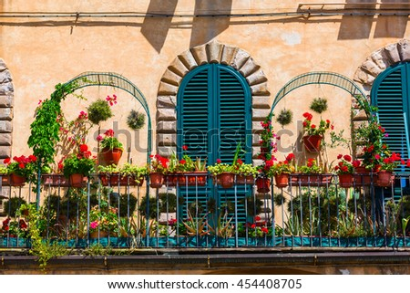 picturesque flower decorated balcony in Lucca, Italy