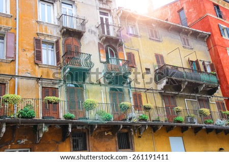 Picturesque house on the square Piazza delle Erbe on a sunny day. Verona, Italy - stock photo