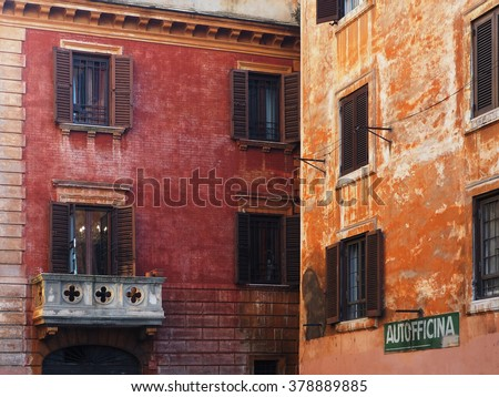 Picturesque Italian facade with garage sign.