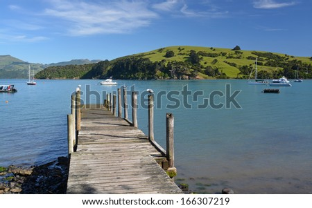 Picturesque jetty on the foreshore of  the tourist town of Akaroa, Canterbury New Zealand.  - stock photo