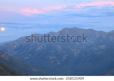 picturesque landscape moonrise in the Baikal Mountains during the night summer night - stock photo