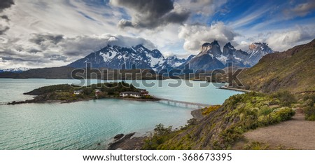Picturesque little island in the lake Pehoe. National Park Torres del Paine, Chile. - stock photo