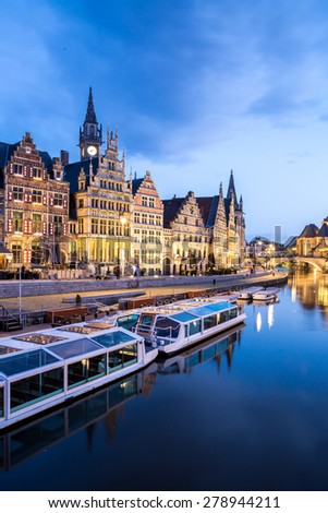 Picturesque medieval buildings on Leie river in Ghent town, Belgium at dusk. - stock photo