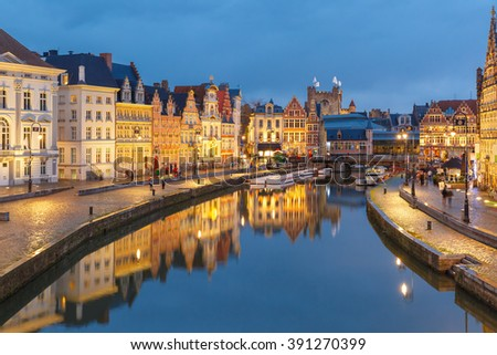 Picturesque medieval buildings on quay Korenlei and  quay Graslei,  Leie river in the evening, blue hour, Ghent, Belgium - stock photo