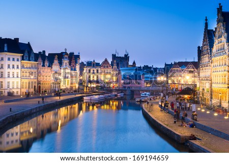 """Picturesque medieval buildings overlooking the """"Graslei harbor"""" on Leie river in Ghent town, Belgium, Europe. - stock photo"""
