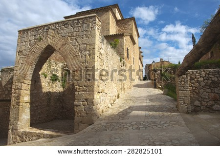 Picturesque medieval corner of a quaint hill town in tarragona, spain. - stock photo