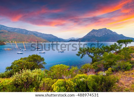 Picturesque Mediterranean seascape in Turkey. Colorful spring sunrise in Adrasan bay with view of Moses Mountain. District of Kemer, Antalya Province. Artistic style post processed photo.
