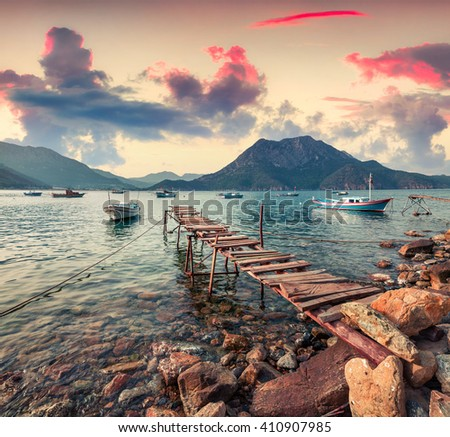 Picturesque Mediterranean seascape in Turkey. Colorful spring sunset in Adrasan bay with view of Moses Mountain. Artistic style post processed photo.