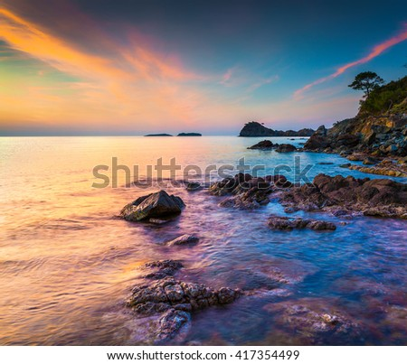 Picturesque Mediterranean seascape in Turkey. Colorful sunrise in a small bay near the Tekirova village, District of Kemer, Antalya Province. Artistic style post processed photo. - stock photo