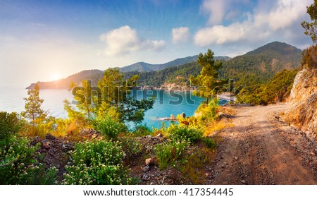 Picturesque Mediterranean seascape in Turkey. View of a small bay near the Tekirova village, District of Kemer, Antalya Province. Artistic style post processed photo. - stock photo