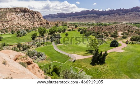 Picturesque Moab public Golf Course nestled amongst the red rocks in Moab, Utah.