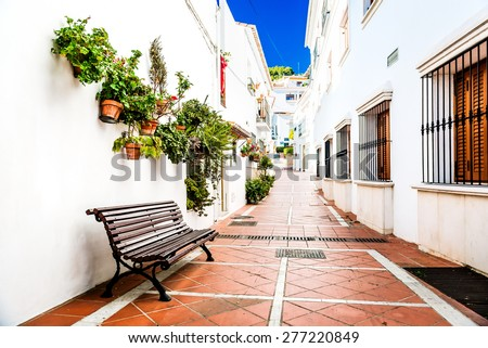 Picturesque narrow street of Rancho Domingo. Charming white village in Benalmadena. Andalusia, southern Spain - stock photo