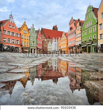 Picturesque Old Gothic Houses Reflecting Puddle Stock