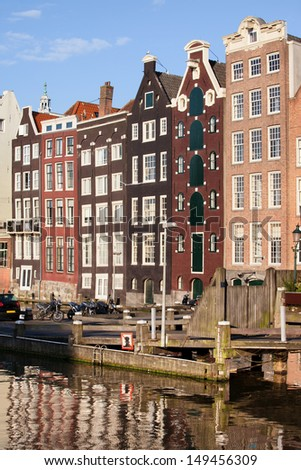 Picturesque old houses by the canal in the city of Amsterdam, Holland, Netherlands.