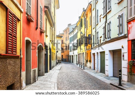 Picturesque old street with colorful architecture in Parma, Emilia-Romagna province, Italy. - stock photo