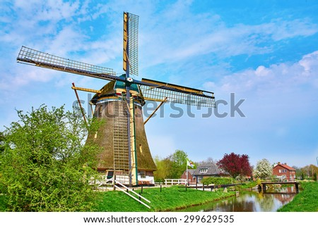 Picturesque old wind mill in the Netherlands - stock photo