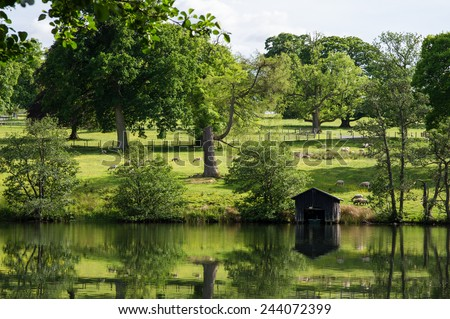Picturesque pastures with sheep, Scotland, UK - stock photo