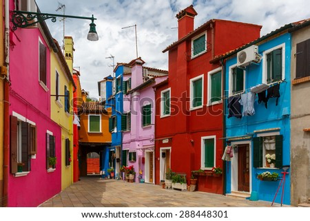 Picturesque patio with colorful houses on the famous island Burano, Venice, Italy - stock photo