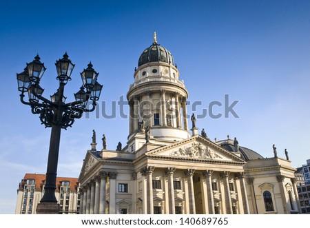 Picturesque paved Neoclassical square popular with both Berliners and tourists. The Deutscher (1785) and the Franzosischer Dom (1701) reside in this beautiful area of Berlin. - stock photo
