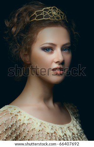 Picturesque portrait of majestic young woman with blue eyes in low key