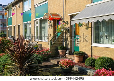 Picturesque residential house with decorative plants before it in small Dutch town Zwanenburg, the Netherlands - stock photo