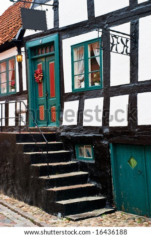 Picturesque restaurant in a half timbered house - stock photo
