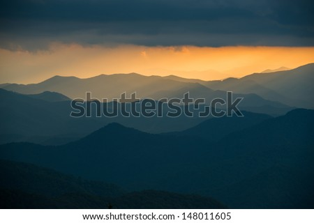 Picturesque ridges of the Appalachian Mountains at sunset along the Blue Ridge Parkway in Western North Carolina. - stock photo