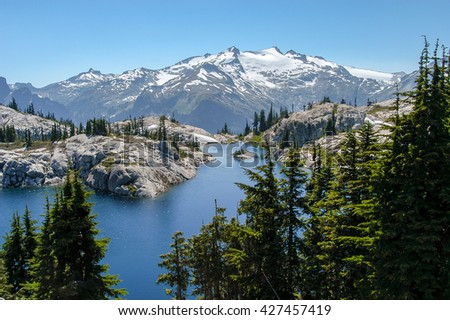 Picturesque Robin Lake with Mt. Daniel towering in the background in the Alpine Lakes Wilderness, Washington State, USA - stock photo